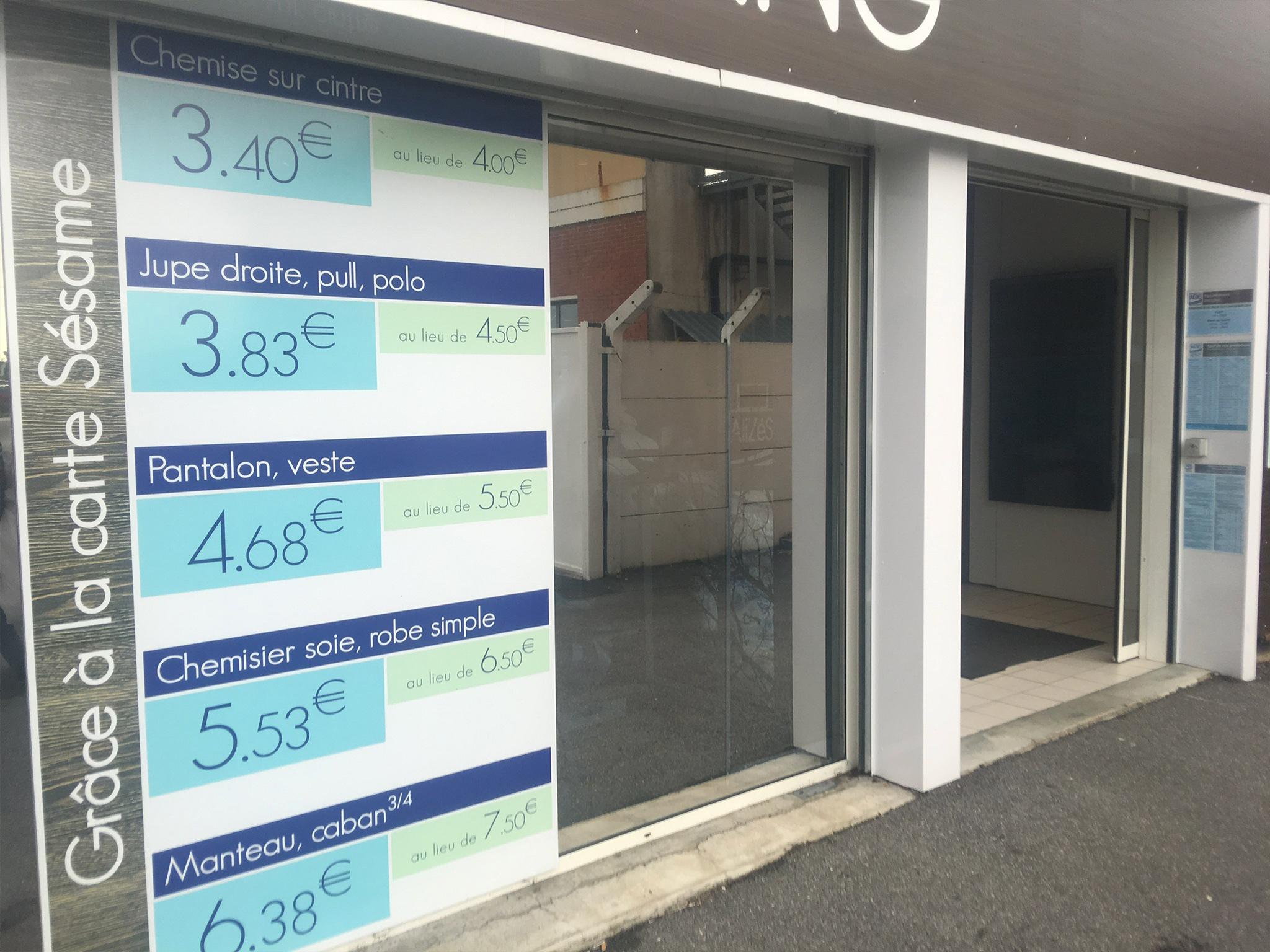 Pose de film solaire sur vitrage de magasin Pressing Lille